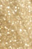 Goldene Funkelnunschärfe Stockbild