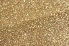 Goldene Funkelnunschärfe Stockbilder