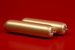 Goldene gekochte Wurst auf Braun Stockfotografie
