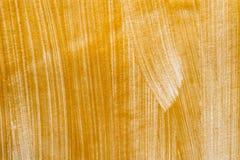 Goldene gemalte Hintergrundbeschaffenheit Stockbilder
