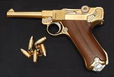 Goldene Gewehr Lizenzfreie Stockbilder
