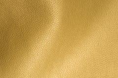 Goldene glatte Kunstleder-Hintergrund-Beschaffenheits-Nahaufnahme Stockfotografie