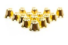 Goldene Glocke auf weißem Hintergrund Stockbilder