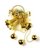 Goldene Glocke mit einer Feiertagsdekoration Stockfotografie