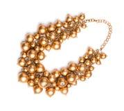 Goldene Halskette der Mode Stockfotos