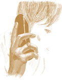 Goldene Hand hält das Telefon an Stockfoto