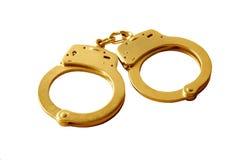 Goldene Handschellen Lizenzfreie Stockbilder