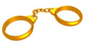 Goldene Handschellen in Form von Hochzeitsringen Stockbild