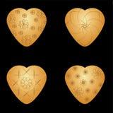 Goldene Herzen des Vektors mit goldenem grafischem Muster Lizenzfreies Stockfoto