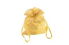 Goldene kleine Tasche lokalisiert auf weißem Hintergrund Stockbild