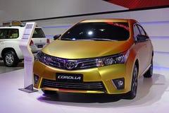 Goldene Korolla Toyotas Stockfotos