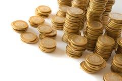 Goldene Münzen des Geldes Stockfotografie