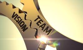 Goldene metallische Zahnräder mit Team Vision Concept 3d Stockfotos