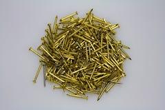 Goldene Nägel Stockbild