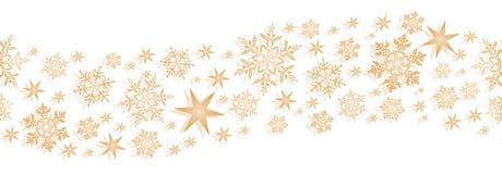 Goldene nahtlose Grenze mit Sternen und Schneeflocken Stockfotos
