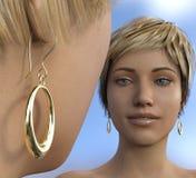 Goldene Ohrringe mit Spiegelansicht Stockfotos