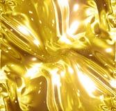 Goldene Packpapier- oder Satinbeschaffenheit Lizenzfreie Stockfotos