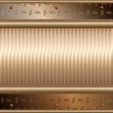 Goldene Platten über metallischer Oberfläche Stockfoto