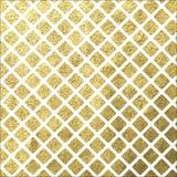 Goldene quadratische Fliese auf weißem Hintergrund Lizenzfreies Stockfoto