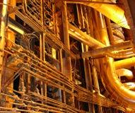 Goldene Rohrleitungen Stockbilder
