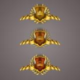 Goldene Schilder mit Lorbeerkranz Stockbilder