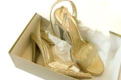 Goldene Schuhe Stockfoto
