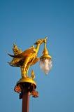Goldene Schwanlampe Stockfoto