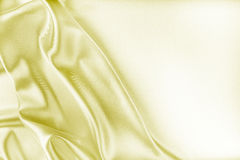 Goldene Seidengewebe-Beschaffenheit Lizenzfreie Stockfotos