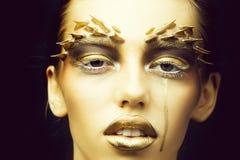 Goldene sexy Frau stockfotos
