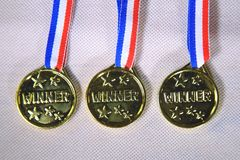 Goldene Siegermedaillen Lizenzfreie Stockfotos