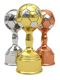 Goldene, silberne und Bronzefußballtrophäen Stockbild