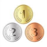 Goldene, silberne und Bronzemedaille Stockfotos