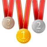 Goldene, silberne und Bronzemedaillen Stockfotos
