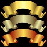 Goldene, silbrige und Bronzefahnen Stockfotos