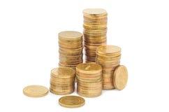 Goldene Spaltenmünzen lizenzfreie stockfotografie