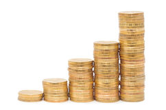 Goldene Spaltenmünzen lizenzfreies stockfoto