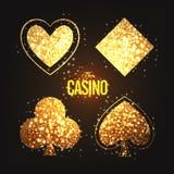 Goldene Spielkartesymbole für Kasino Lizenzfreies Stockfoto