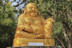 Goldene Statue Katyayana sind wohlhabendes Symbol Lizenzfreies Stockbild
