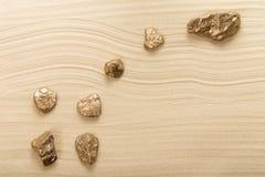 Goldene Steine in der Form der Konstellation Lizenzfreie Stockbilder