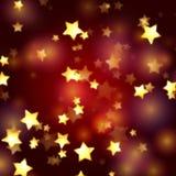Goldene Sterne in den roten und violetten Leuchten Stockfotografie