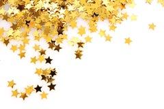 Goldene Sterne in Form von Confetti Stockbild