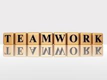 Goldene Teamwork mit reflectio Lizenzfreies Stockfoto