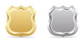 Goldene und silberne Abzeichen Lizenzfreie Stockfotos