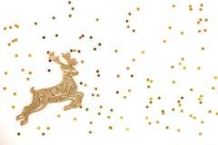 Goldene Weihnachtsrotwild auf goldenem Sternhintergrund stockfotos