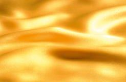 Goldene Welle des Tuches Stockbild