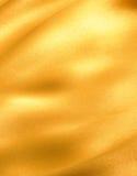 Goldene Welle des Tuches Lizenzfreie Stockbilder