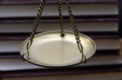 Goldene wiegende Skala Lizenzfreies Stockbild
