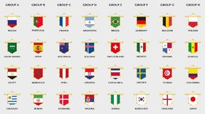 Goldene Wimpel mit Flaggendesign von Fußballländern Stockbild