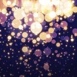 Goldener abstrakter Bokeh-Licht Hintergrund Stockbild