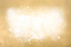 Goldener abstrakter festlicher Hintergrund Feiertags-Funkeln Defocused Stockfotografie